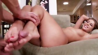 She is putting her feet in the mouth of a horny dude