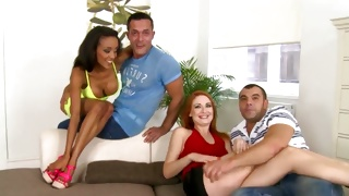 Two sweet babes sitting on these dude's laps in a hot way