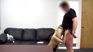 Playful blonde is taking off her bra in a dirty way