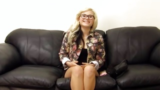 Blonde chick is lying there and gets her pussy poked
