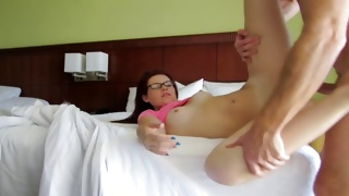 Red haired delicious bitch is kneeling on the bed